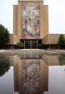 "This July 31, 2008 photo show the Hesburgh Library on the campus of Notre Dame University in Notre Dame, Indiana. The library is adorned with the mosaic ""The Word of Life"", which depicts Christ the teacher surrounded by saints and scholars. The mosaic is also referred to a ""Touchdon Jesus"", because it happens to align with end zone of Notre Dame's football stadium and it appears that Jesus is signaling touchdown. AFP PHOTO/Karen BLEIER (Photo credit should read KAREN BLEIER/AFP/Getty Images)"