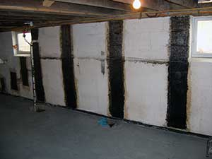 bowed basement wall repaired with stronghold carbon fiber basement