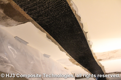StrongHold's carbon fiber straps are applied to the cracked ceiling.