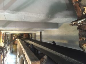 CarbonSeal system installation with topcoat applied to beams, slabs and walls.