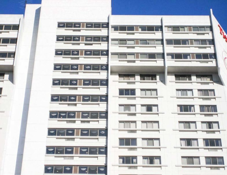 Exterior of the high-rise after the system was installed and painted over to suit the building aesthetics.