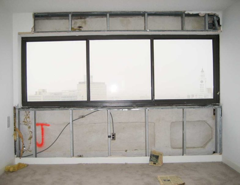 interior of the high-rise showing cracks, holes and mold