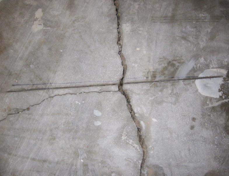 Uneven soil caused this concrete slab floor to develop large cracks.