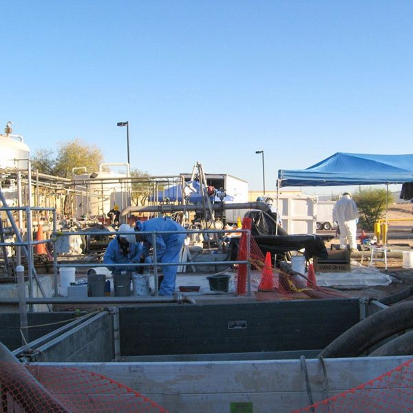 Chemical processing plant staging work site for underground chemical wastewater concrete tank repair