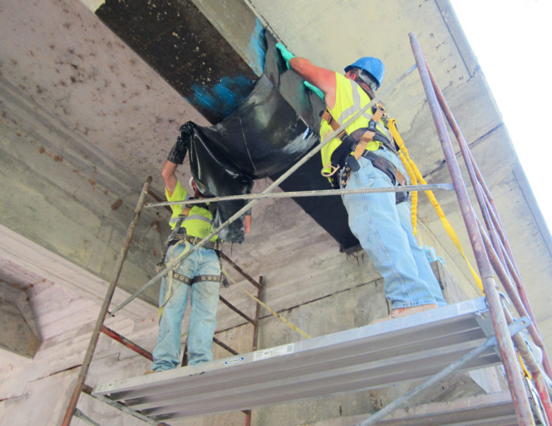 HJ3 applying CarbonSeal to beam